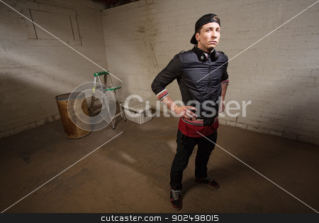 Tough Guy Posing stock photo, Tough urban man with hands on hips in building by Scott Griessel