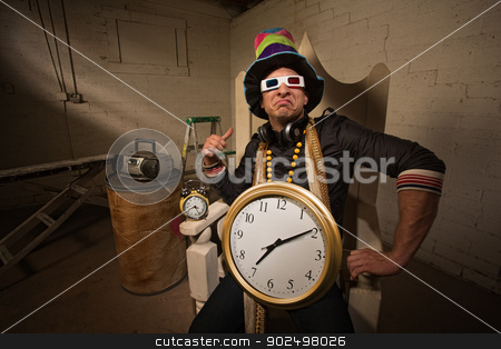 Poser in Large Hat and Clock stock photo, Pouting rapper in throne with large hat and clock by Scott Griessel