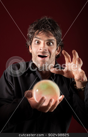 Excited Fortuneteller stock photo, Excited fortuneteller gazes over a crystal ball by Scott Griessel