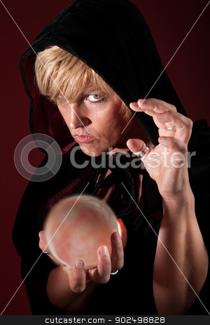 Fortune Teller stock photo, Hooded blonde female fortuneteller with her crystal ball by Scott Griessel
