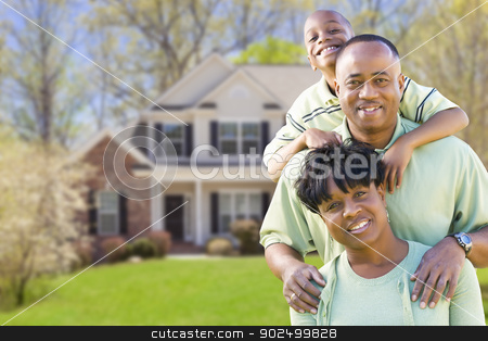 African American Family In Front of Beautiful House stock photo, Happy African American Family In Front of Beautiful House. by Andy Dean