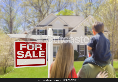 Family Facing For Sale Real Estate Sign and House stock photo, Curious Family Facing For Sale Real Estate Sign and Beautiful New House. by Andy Dean