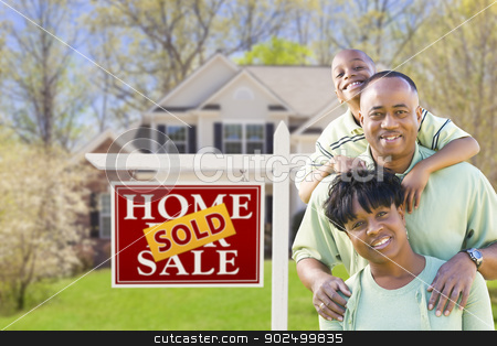 African American Family In Front of Sold Sign and House stock photo, Happy African American Family In Front of Sold Real Estate Sign and House. by Andy Dean