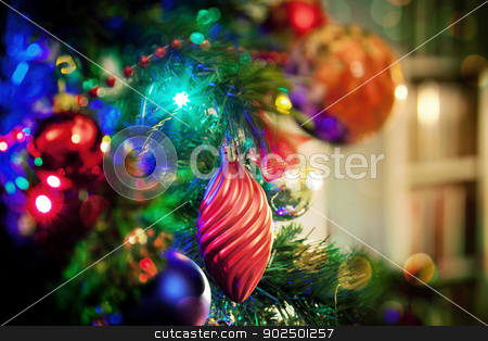 Baubles and lights on Christmas tree stock photo, Baubles and sparkling lights on Christmas tree at home. by Piccia Neri
