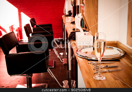 Hairdresser's salon stock photo, At the hairdresser's: a glass of champagne to welcome clients. by Piccia Neri