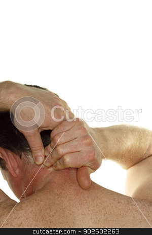 Neck Pain stock photo, Nude middle aged man seen from behind rubbing his neck with his hands in front of a white background. by Lee Serenethos