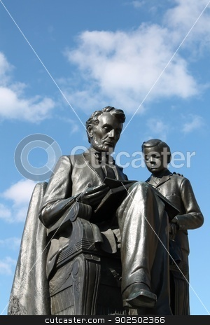 Abraham Lincoln Statue stock photo, Statue of Abraham Lincoln reading to his son Tad. by Dustin Ausdemore