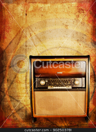 Vintage radio stock photo, Old vintage radio, an original from the 1950s, against distressed abstract background.  by Piccia Neri