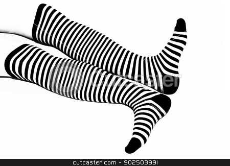 Striped socks stock photo, Woman legs in back and white long striped socks isolated on white background by Inna Malostovker