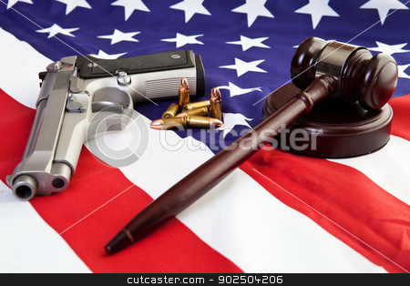 American Gun Laws stock photo, Photo of gavel, gun, and bullets over an american flag. by Scott Little