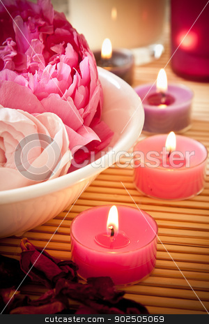 Aromatherapy flowers and candles stock photo, A bowl full of beautiful pink aromatherapy flowers with candles. Spa scene. by Piccia Neri