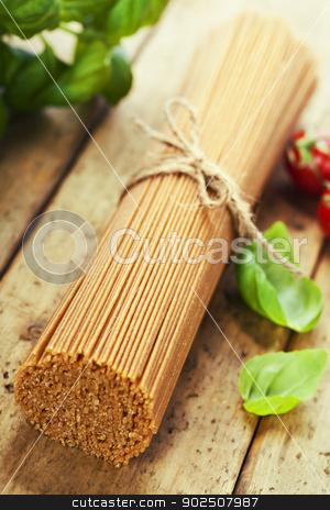 whole wheat spaghetti stock photo, whole wheat spaghetti with basil and tomatoe by klenova