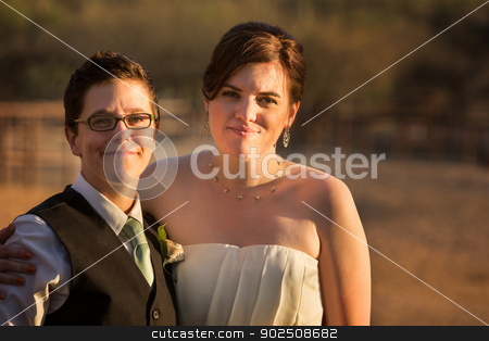Smiling Gay Couple stock photo, Smiling same sex couple at civil union by Scott Griessel