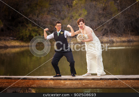 Same Sex Couple Having Fun at Lake stock photo, Same sex female couple having fun on dock near lake by Scott Griessel