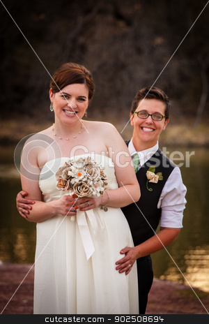 Couple Posing for Civil Union stock photo, Happy gay couple standing together for civil union by Scott Griessel