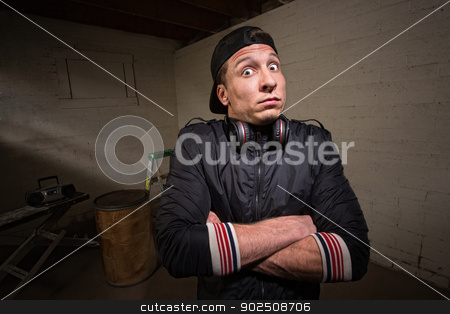 Anxious Man with Headphones stock photo, Nervous man with headphones and folded arms by Scott Griessel