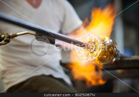 Flames on Fine Art Glass stock photo, Blowtorch flames surrounding fine art glass object by Scott Griessel