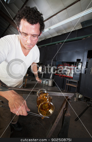 Artist Trimming Glass Vase stock photo, Mexican glass artisan trimming vase on workbench by Scott Griessel