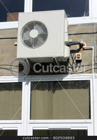 Industrial exractor fan stock photo, Industrial exractor fan on exterior of modern school building. by Martin Crowdy