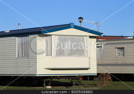 Mobile homes on a caravan park stock photo, Scenic view of mobile homes on caravan park, England. by Martin Crowdy