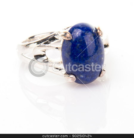 Blue Lapis Lazuli Ring stock photo, Blue lapis lazuli  cabachon gemstone ring isolated on white background. by Cheryl Valle