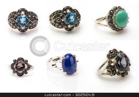 Gemstone Ring Collection stock photo, Six gemstone rings isolated on white background with light shadow. Blue topaz, turquoise, blue lapis lazuli, mystic topaz, and smokey quartz. by Cheryl Valle