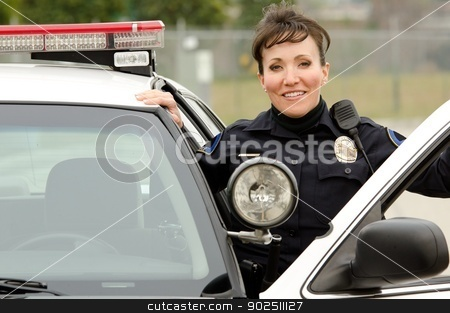 smiling officer stock photo, a friendly and smiling Hispanic female officer with her patrol car.  by John Roman