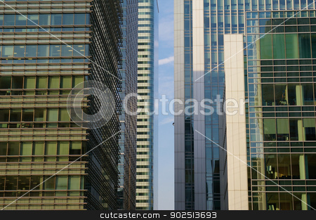 Office buildings in Canary Wharf stock photo, A single stripe of blue skye between office buildings in Canary wharf, London by Harvepino