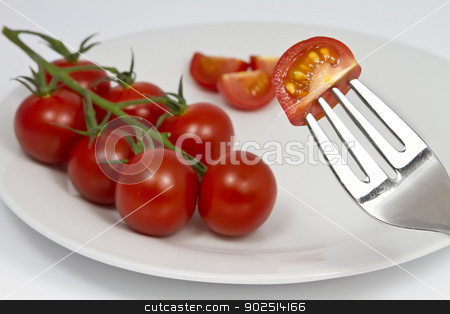 Tomatoes on the Vine stock photo, Tomatoes on the Vine on plate with fork by Goldcoinz