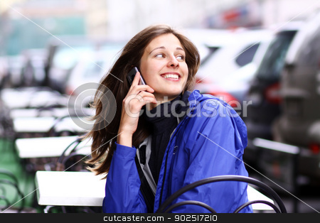 Happy young lady talking on mobile phone stock photo, Happy young lady talking on mobile phone by andersonrise