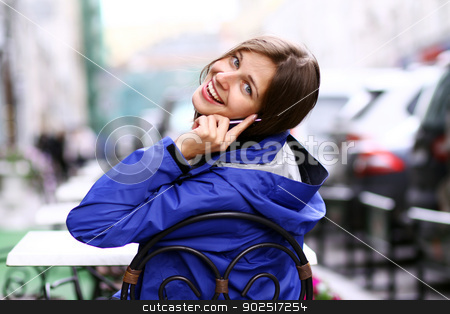Closeup woman with mobile telephone  stock photo, Happy young lady talking on mobile phone by andersonrise