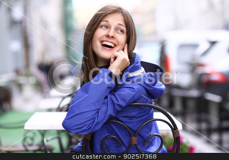 Portrait of young happy smiling woman stock photo, Happy young lady talking on mobile phone by andersonrise
