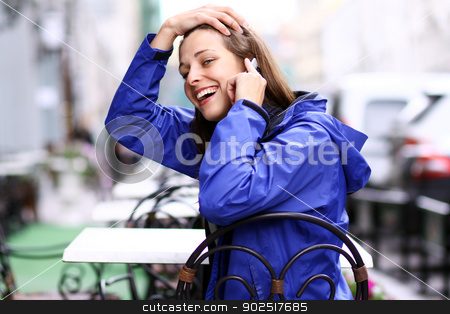 Beautiful young woman stock photo, Happy young lady talking on mobile phone by andersonrise