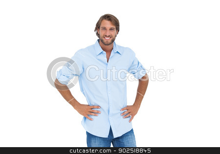 Handsome man smiling with his hands on hips stock photo, Handsome man smiling with his hands on hips on white background by Wavebreak Media