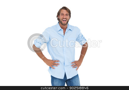 Laughing man with hands on hips stock photo, Laughing man with hands on hips on white background by Wavebreak Media