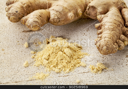 ginger root and powder stock photo, ginger root and powder on a rustic white painted barn wood background by Marek Uliasz