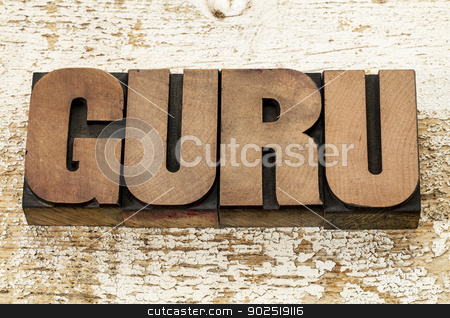 guru word in wood type stock photo, guru word in vintage letterpress wood type blocks against grunge white painted barn wood by Marek Uliasz