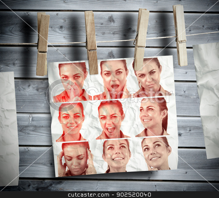Pegs hanging pictures showing woman gesturing stock photo, Pegs hanging pictures showing woman gesturing with wooden boards on the background by Wavebreak Media