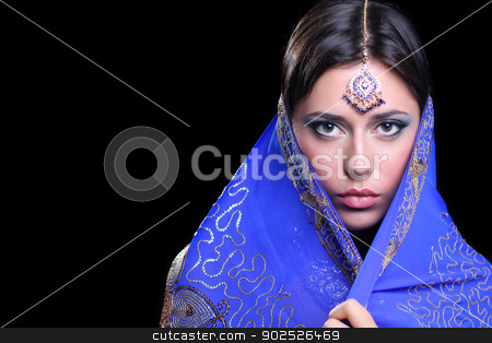 young pretty woman in indian blue dress stock photo, young pretty woman in indian blue dress by andersonrise