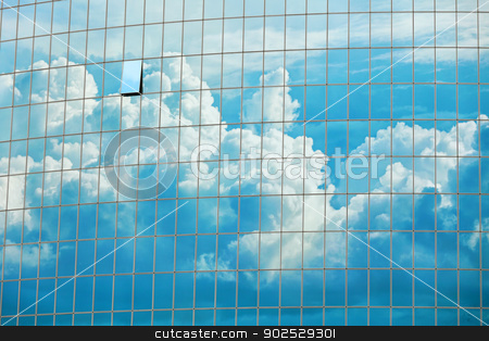 Sky reflected in the skyscraper windows background stock photo, Cloudy sky reflected in the windows of a skyscraper - urban background by Alexey Romanov