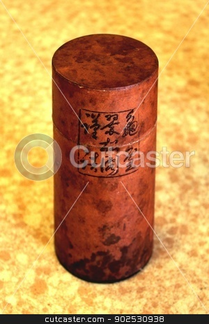Japanese Tea Container stock photo, Small Japanese round cylinder herbal tea box. by Henrik Lehnerer