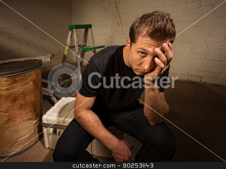 Stressed Out Man stock photo, Stressed out European man sitting in warehouse by Scott Griessel