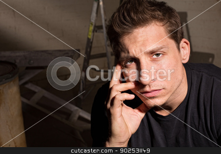 Tired Man Close Up stock photo, Tired Caucasian guy indoors with hand near face by Scott Griessel