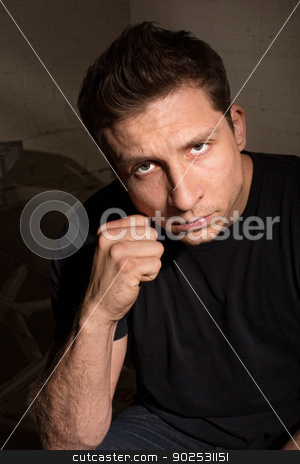 Man with Clenched Fist stock photo, Tense young white man with clenched fist indoors by Scott Griessel