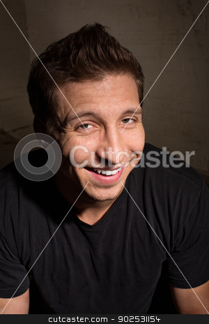 Smiling Man in Black stock photo, Smiling young adult male in black shirt indoors by Scott Griessel