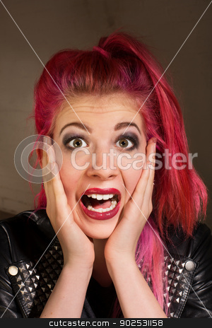 Startled Woman with Pink Hair stock photo, Young punk rocker female with hands on face by Scott Griessel