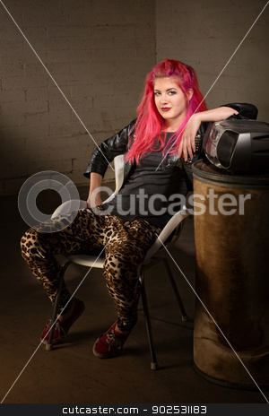 Teenager in Leopard Skin Tights stock photo, Young punk woman in leopard skin tights indoors by Scott Griessel