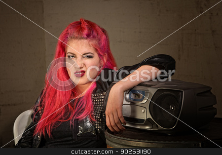 Woman Curling Her Lip stock photo, Bored girl with pink hair and radio curling her lip by Scott Griessel