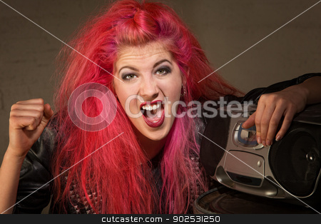 Shouting Girl by Radio stock photo, Shouting young lady in pink with clenched fist and radio by Scott Griessel