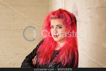 Pretty Teen Leaning Back stock photo, Cute young Caucasian woman leaning against a wall by Scott Griessel